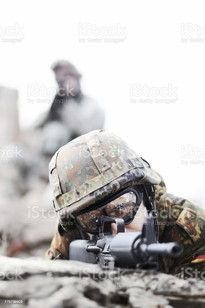 Soldier lying low royalty-free stock photo