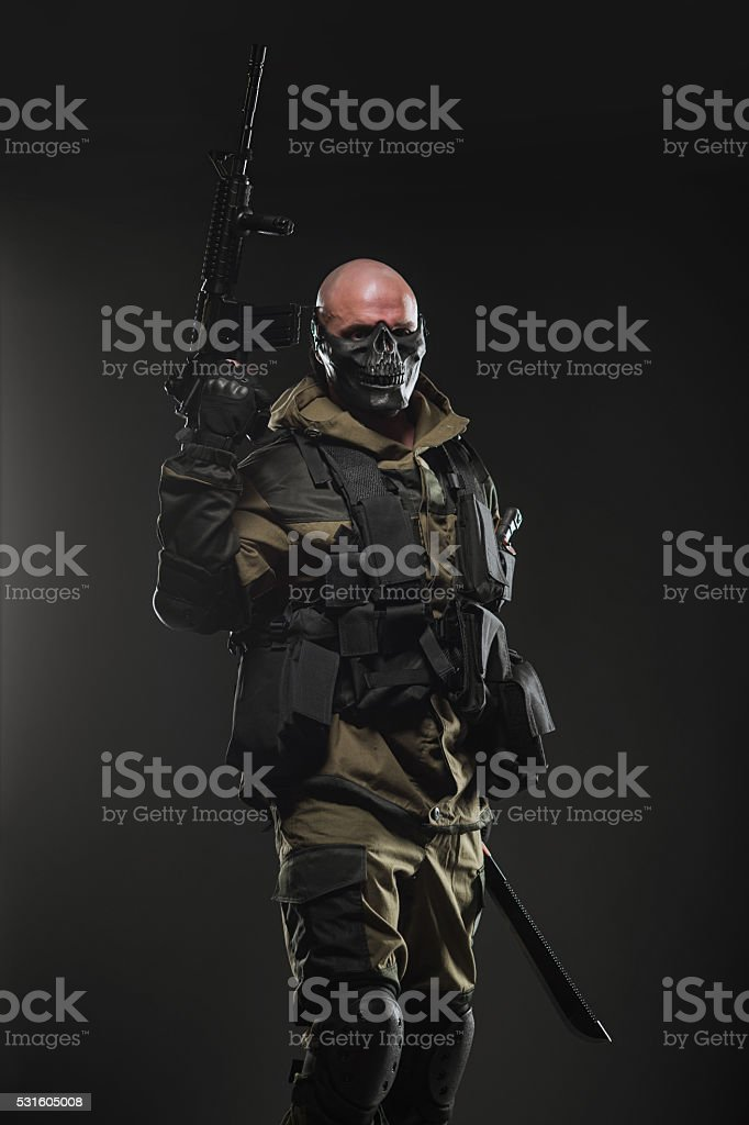 soldier man hold Machine gun on a  dark background stock photo