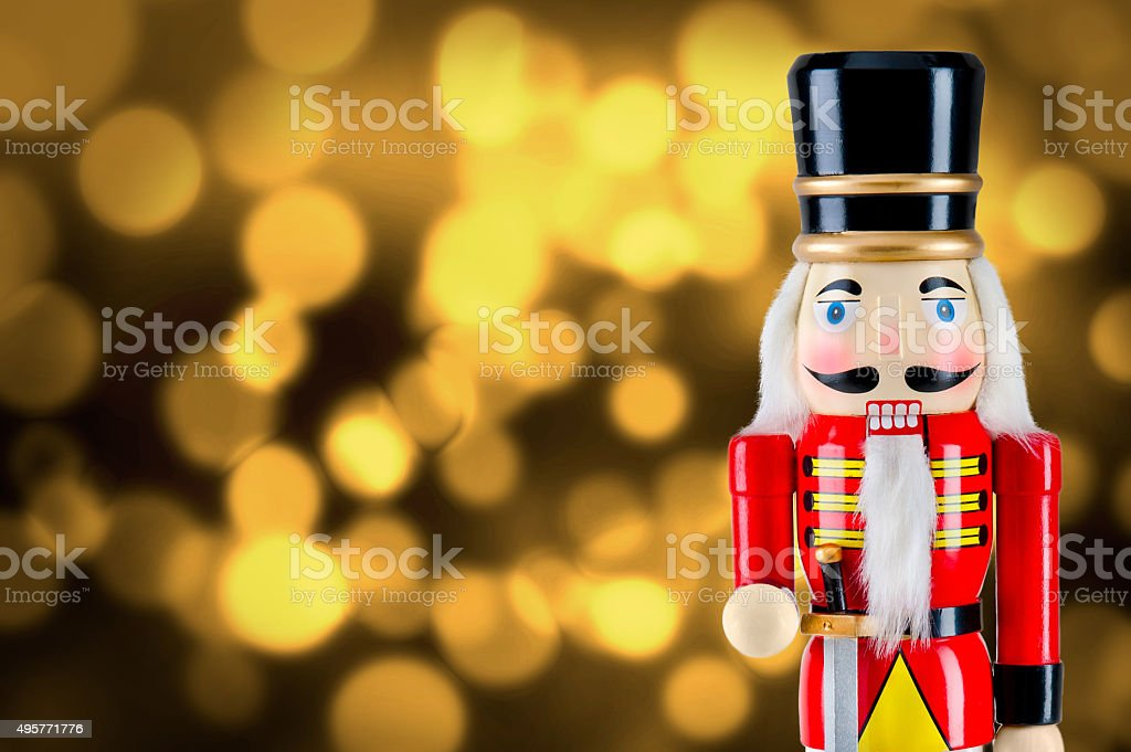 Soldier nutcracker statue standing in front of Christmas lights stock photo