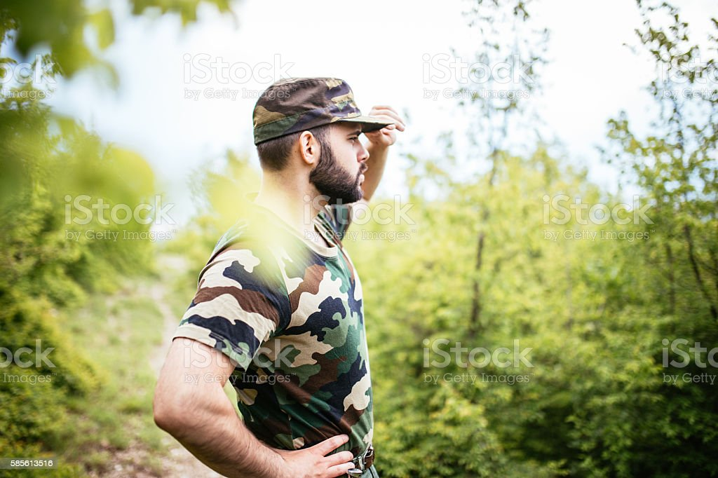 Soldier observing mountain stock photo