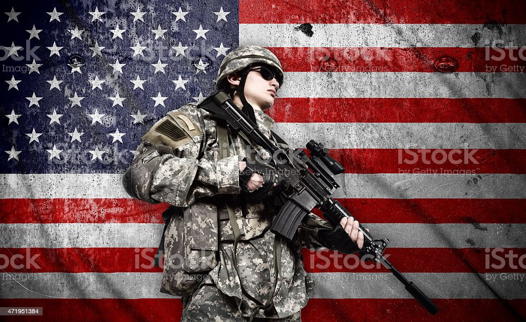 soldier on american flag background stock photo