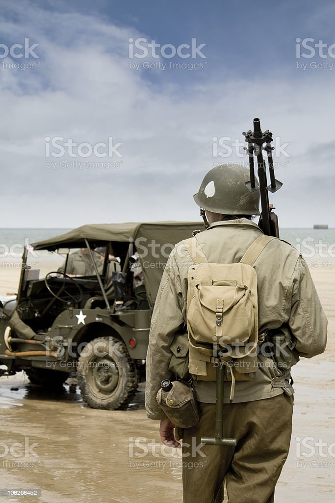 Soldier on beach at D Day stock photo