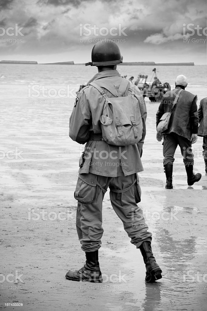 Soldier on beach at D-Day stock photo