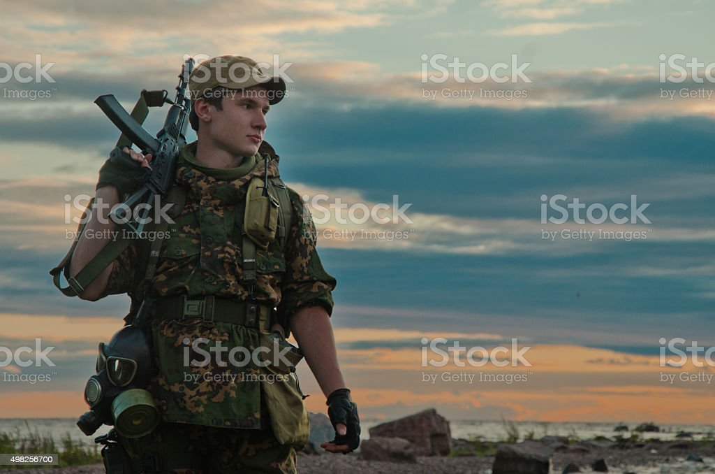 soldier on beach stock photo