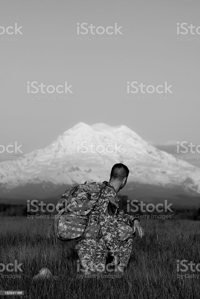 Soldier on his knee stock photo