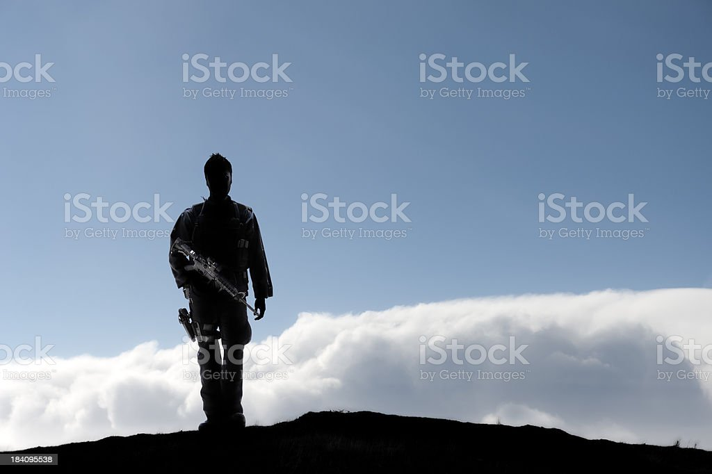 Soldier on Mountain Top royalty-free stock photo