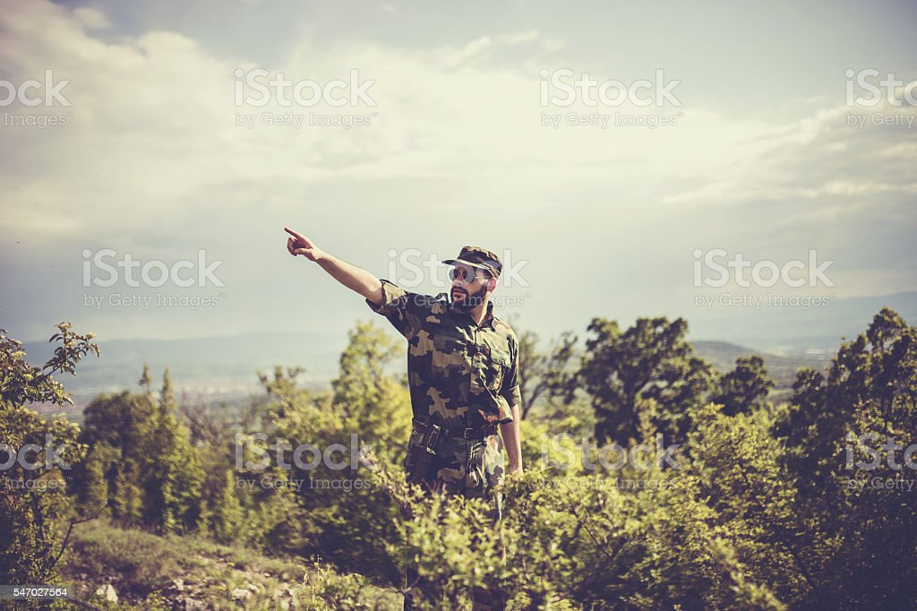 Soldier pointing to the enemy stock photo