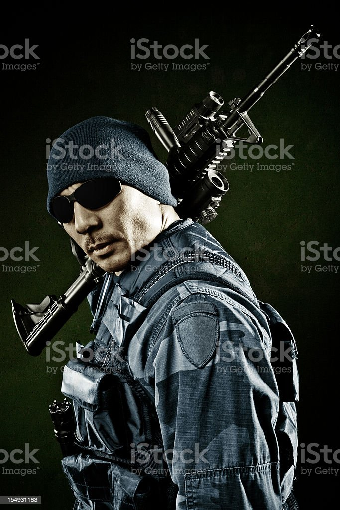 Soldier posing with a gun royalty-free stock photo