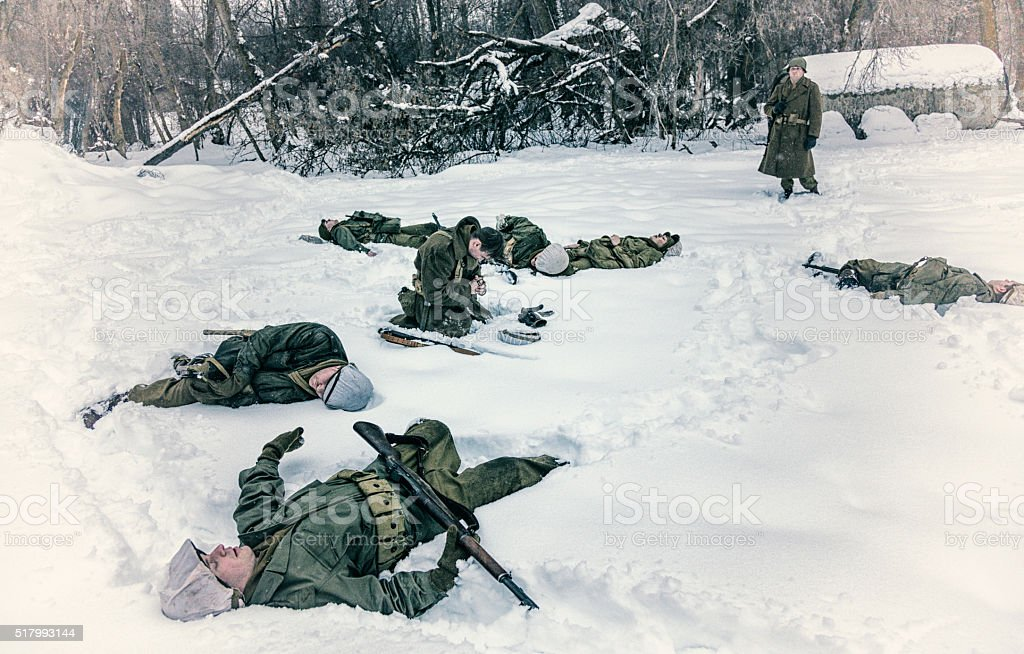 WWII Soldier Praying For Dead Ambushed War Casualties stock photo