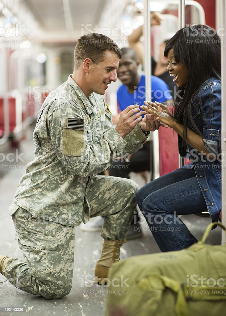 Soldier Proposes to Young Woman Before Deployment stock photo