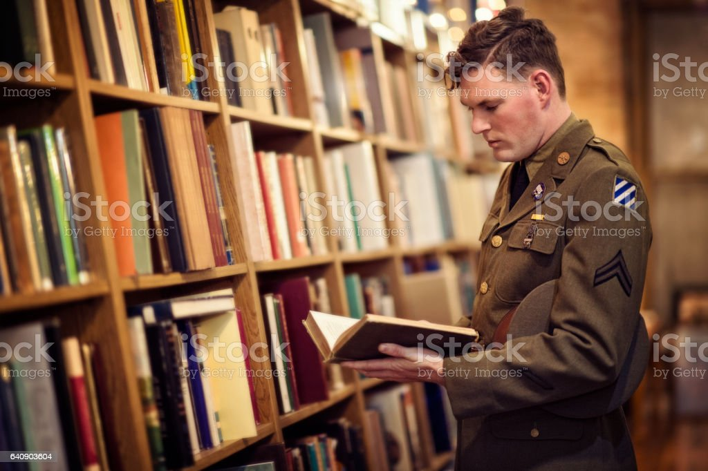 WWII US Soldier Reading In A Public Library stock photo