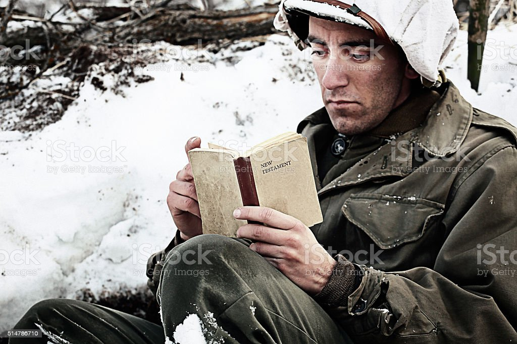 WWII Soldier Reading the Bible stock photo