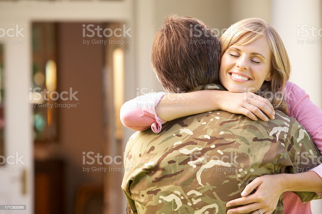 Soldier Returning Home And Greeted By Wife royalty-free stock photo