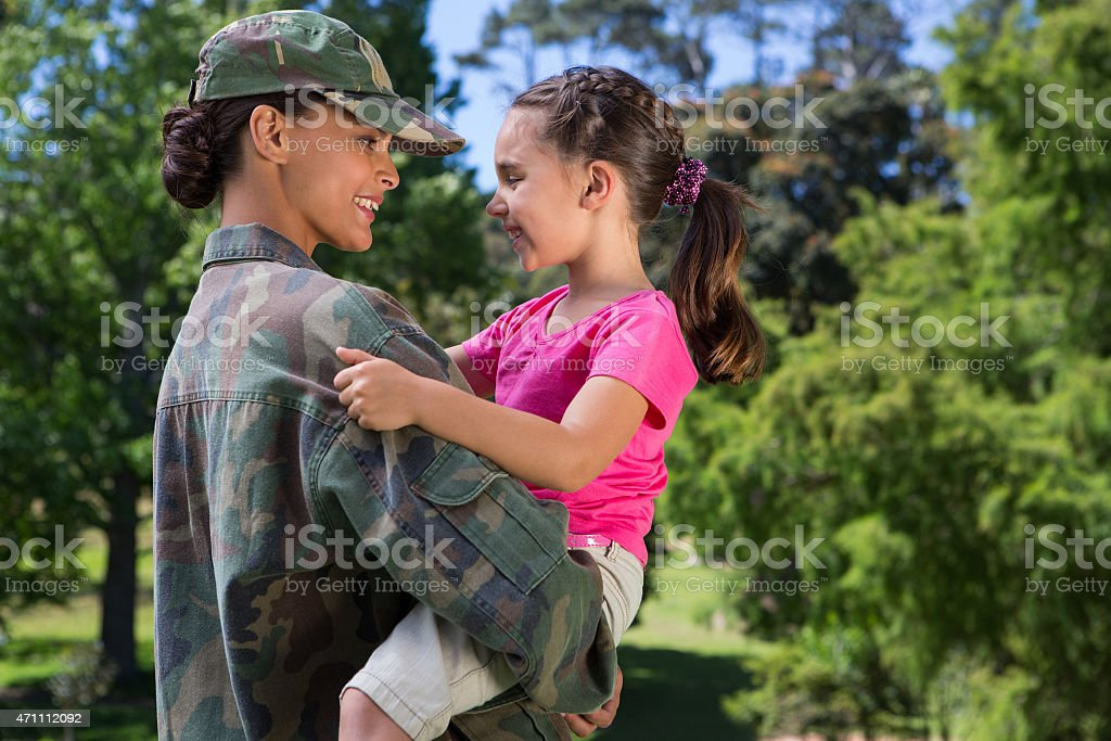 Soldier reunited with her daughter stock photo