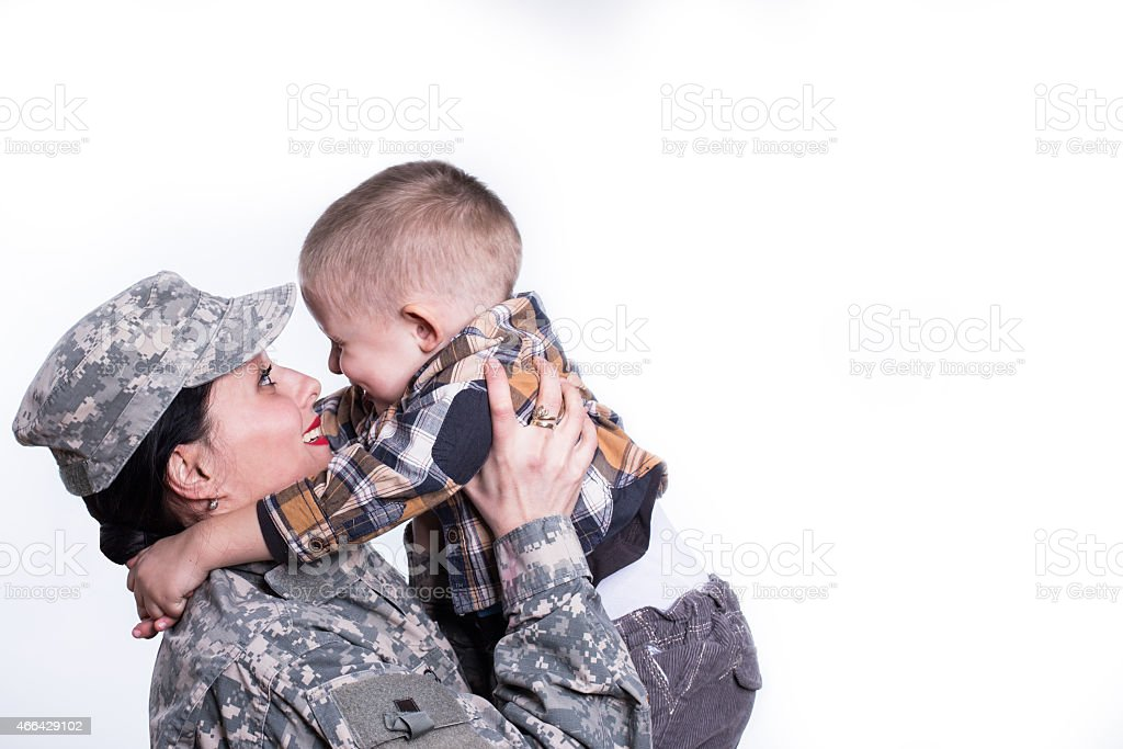 Soldier reunited with her son stock photo