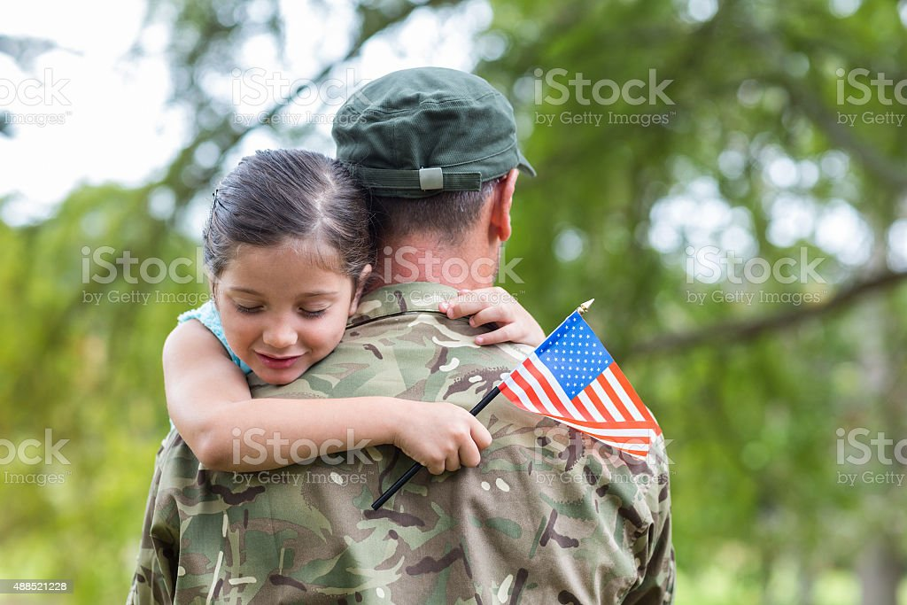Soldier reunited with his daughter stock photo