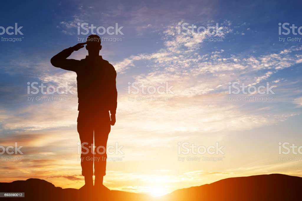 Soldier salute. Silhouette on sunset sky. Army, military. stock photo