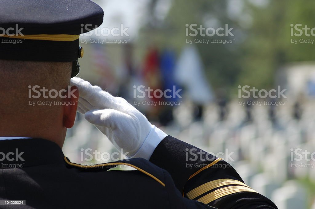 Soldier salutes fallen comrades stock photo