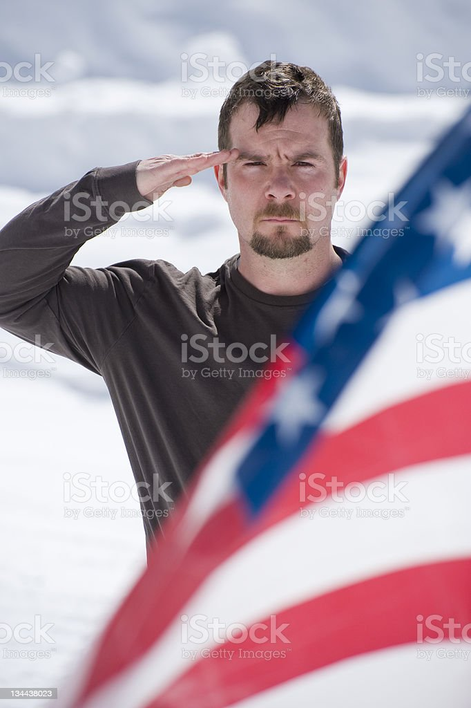 Soldier Salutes the American Flag and Honors a Fallen Comrade royalty-free stock photo