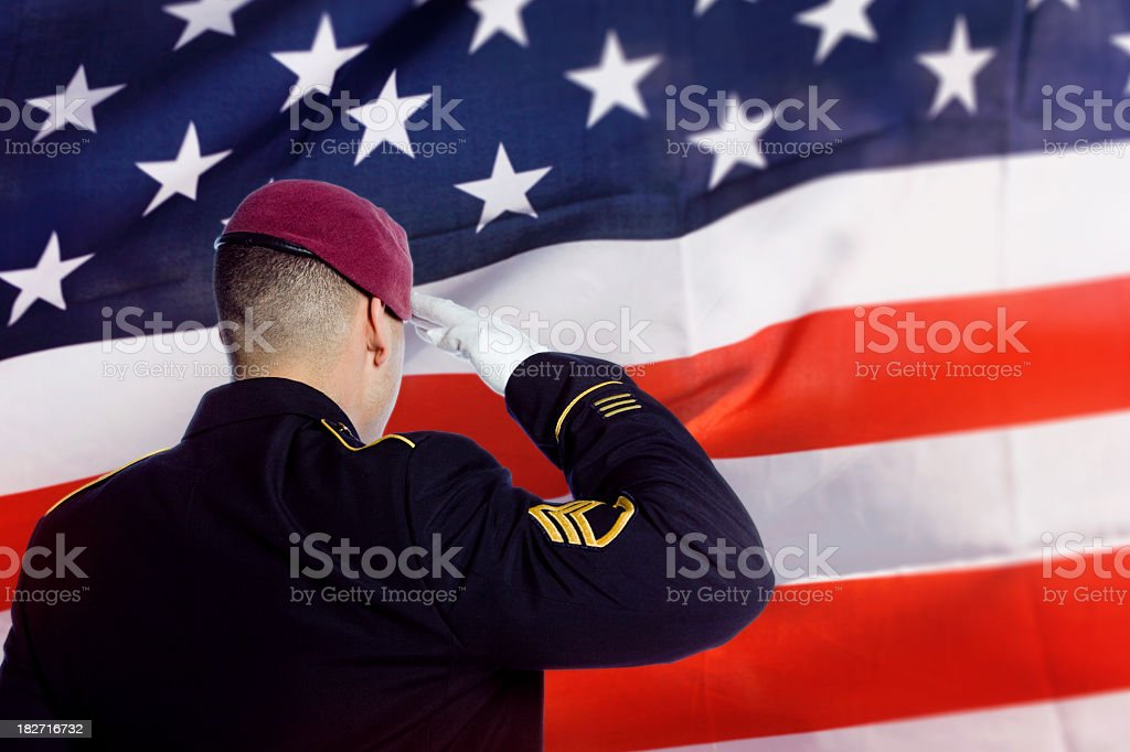 Soldier saluting US flag royalty-free stock photo