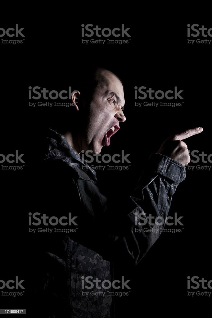 Soldier Screaming and Pointing stock photo