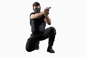 Soldier shooting gun isolated on white