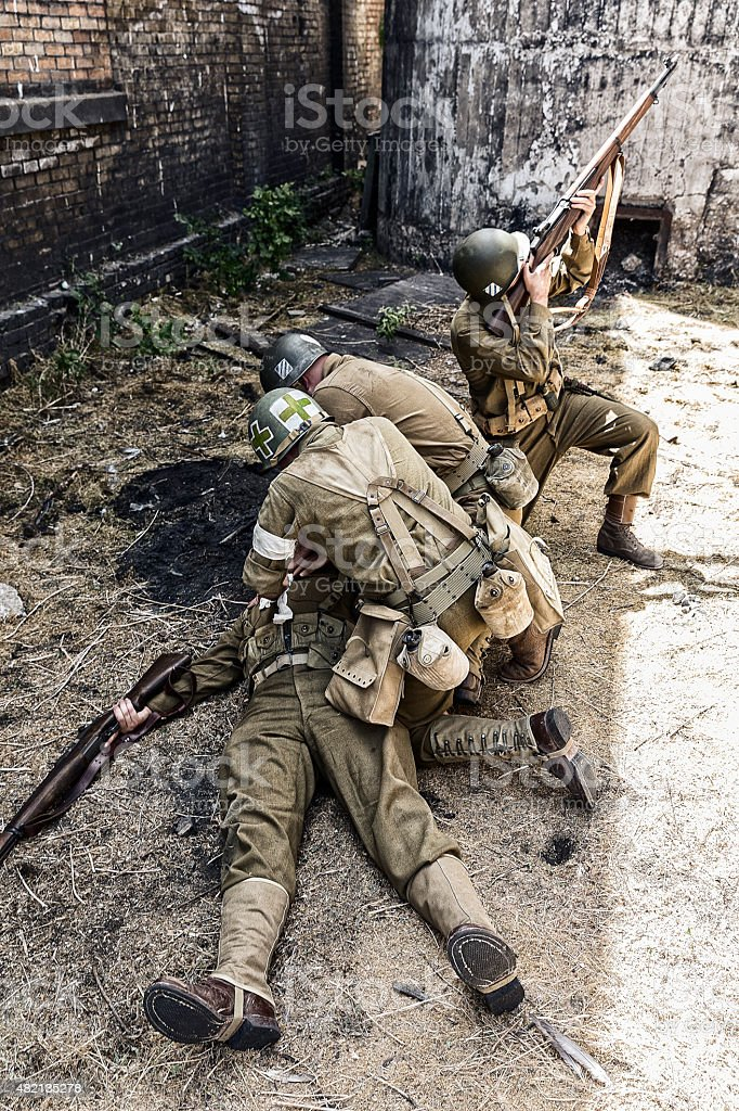 Soldier Shot by Sniper and is Attended by Medic stock photo