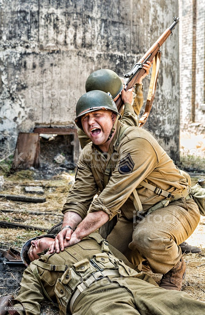 Soldier Shot with His Sargeant Trying to Keep Him Alive stock photo