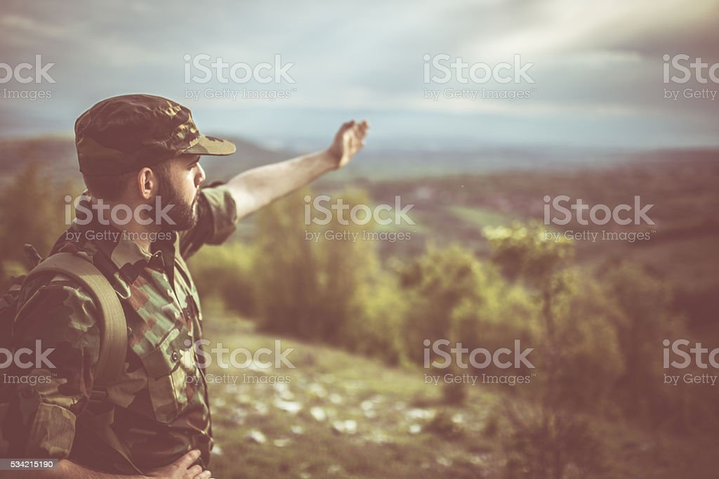 Soldier showing the way stock photo