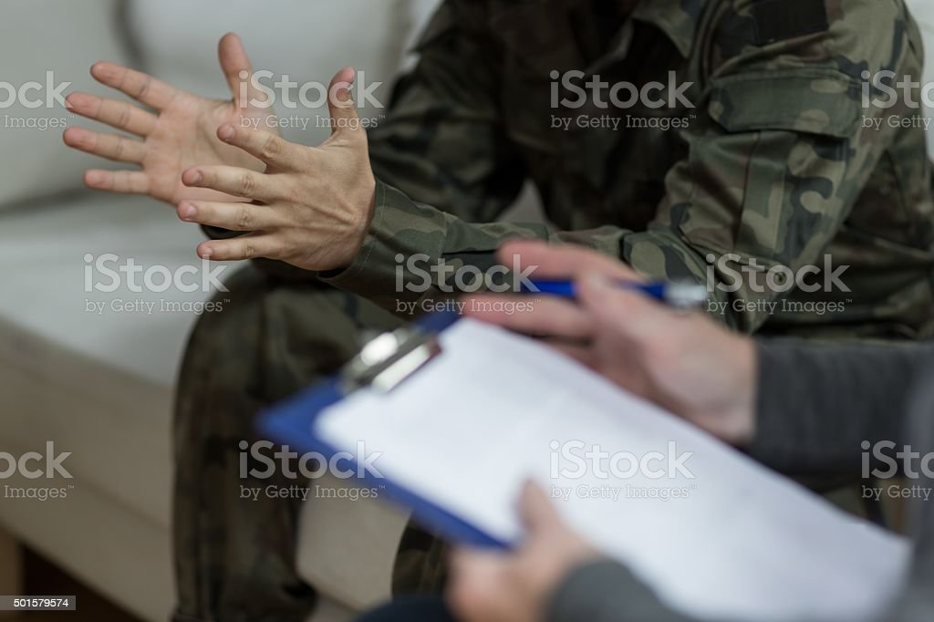Soldier sitting on the sofa stock photo