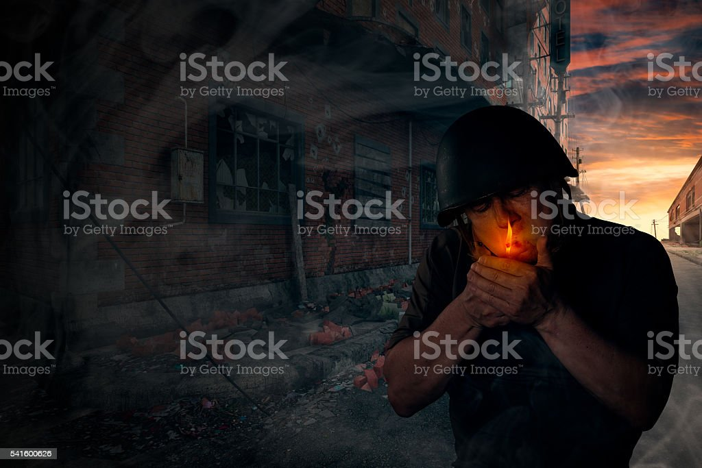 soldier smoking a cigarette stock photo