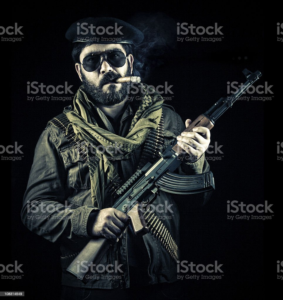 soldier smoking cigar and holding a gun stock photo