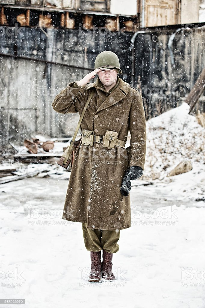 WWII US Soldier Standing At Attention and Saluting stock photo