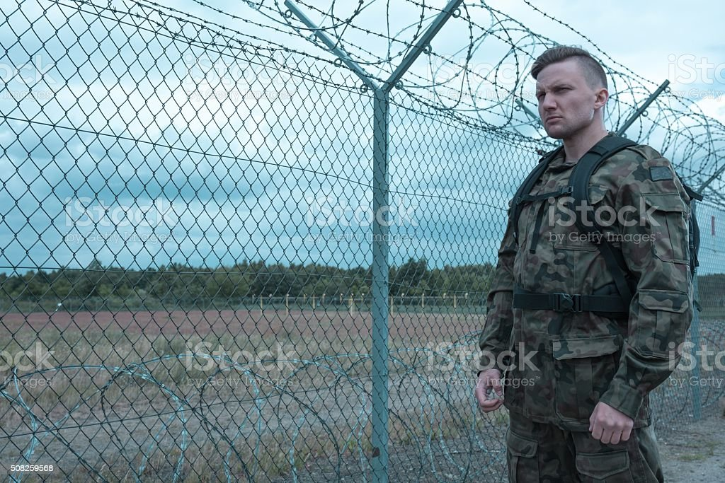 Soldier standing guard stock photo