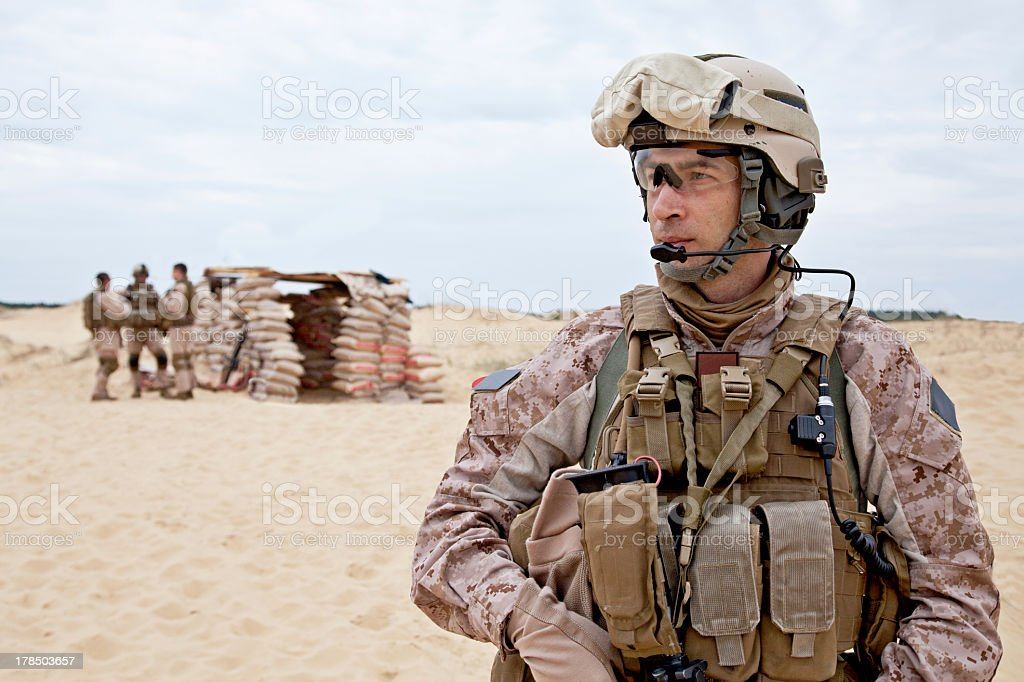 Soldier standing in the desert stock photo