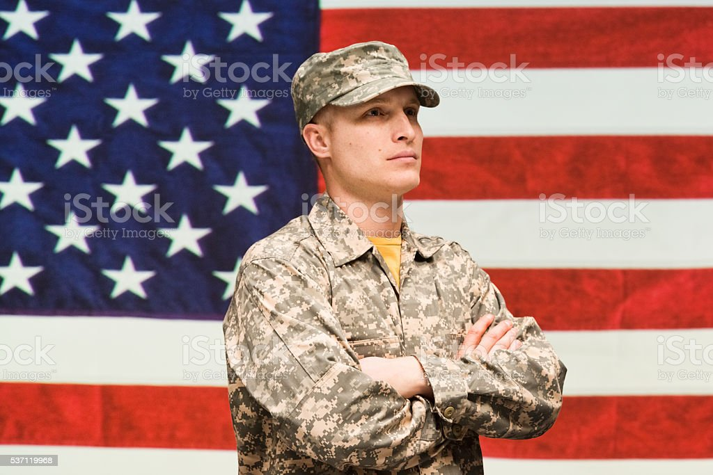 Soldier standing with arms crossed stock photo