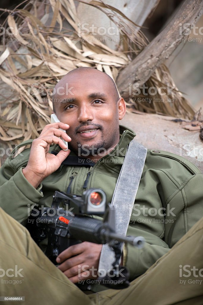 Soldier talking on a cell phone. stock photo
