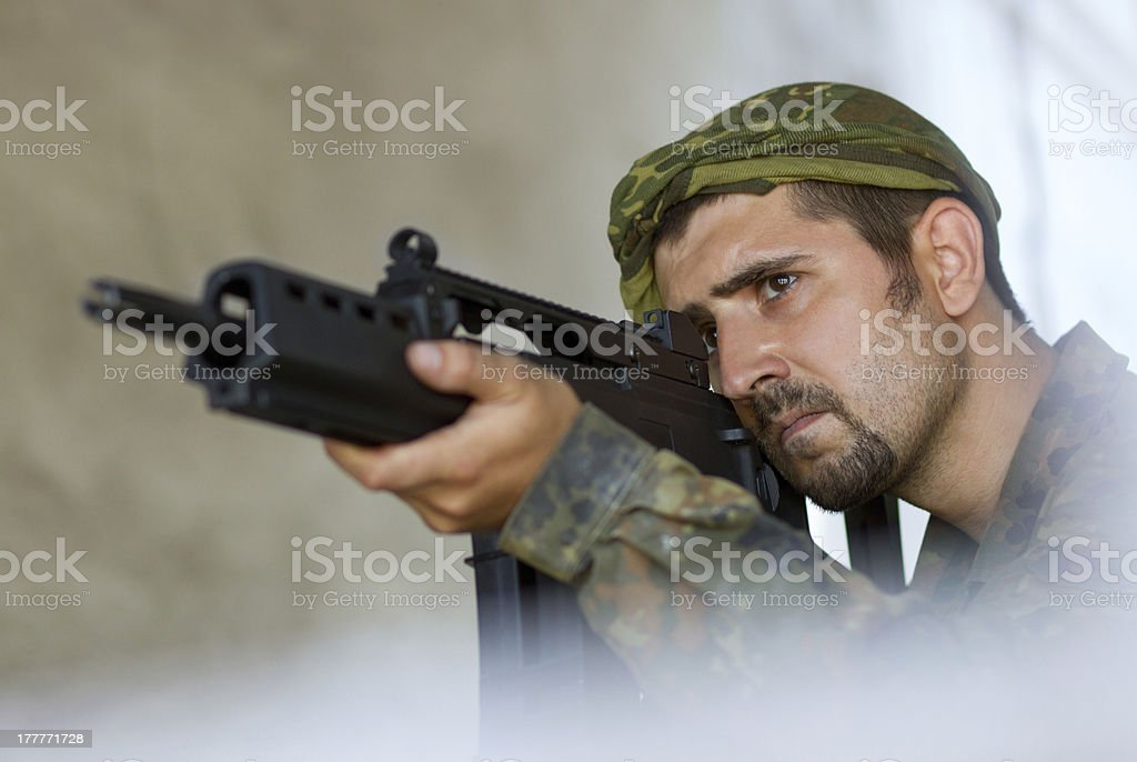 Soldier targeting with a gun royalty-free stock photo
