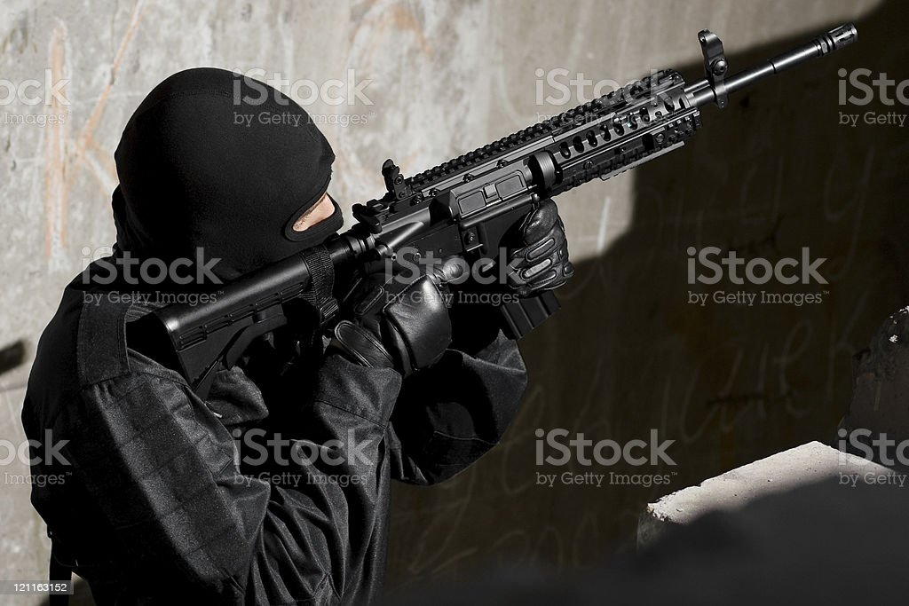 Soldier targeting with a M-4 gun royalty-free stock photo