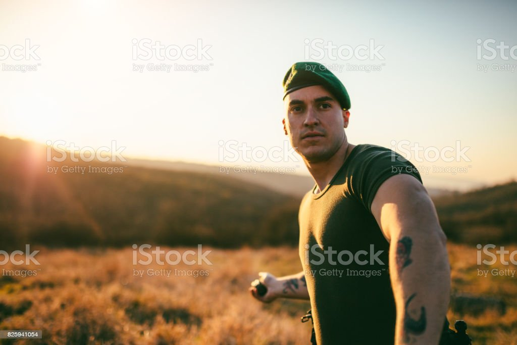 Soldier throwing hand grenade stock photo