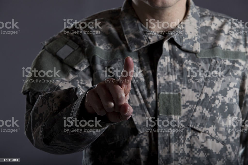 Soldier Touchscreen Finger stock photo