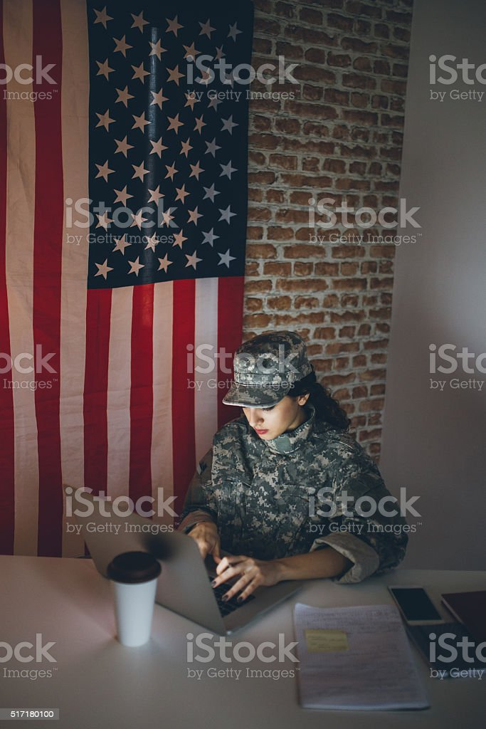 US soldier using computer stock photo