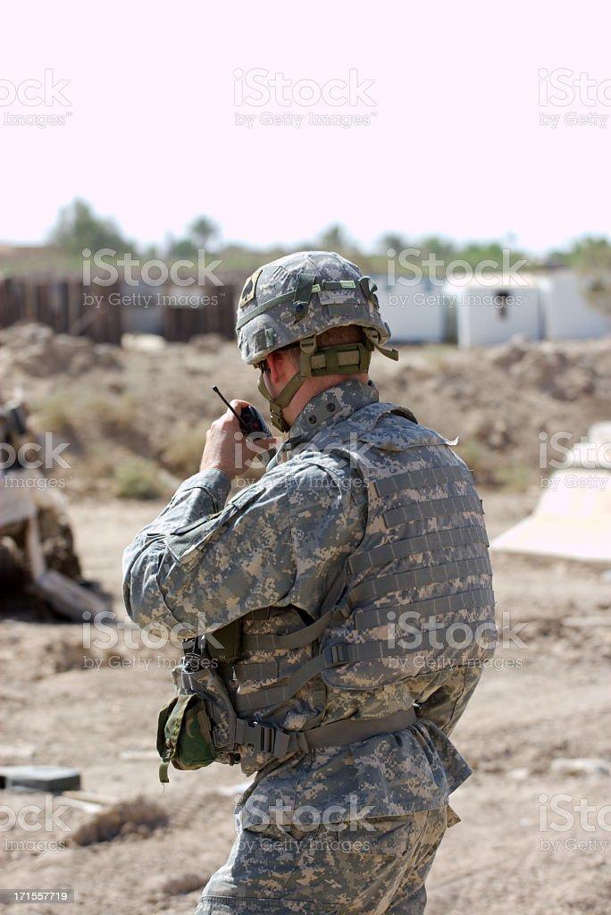 Soldier using radio to communicate stock photo
