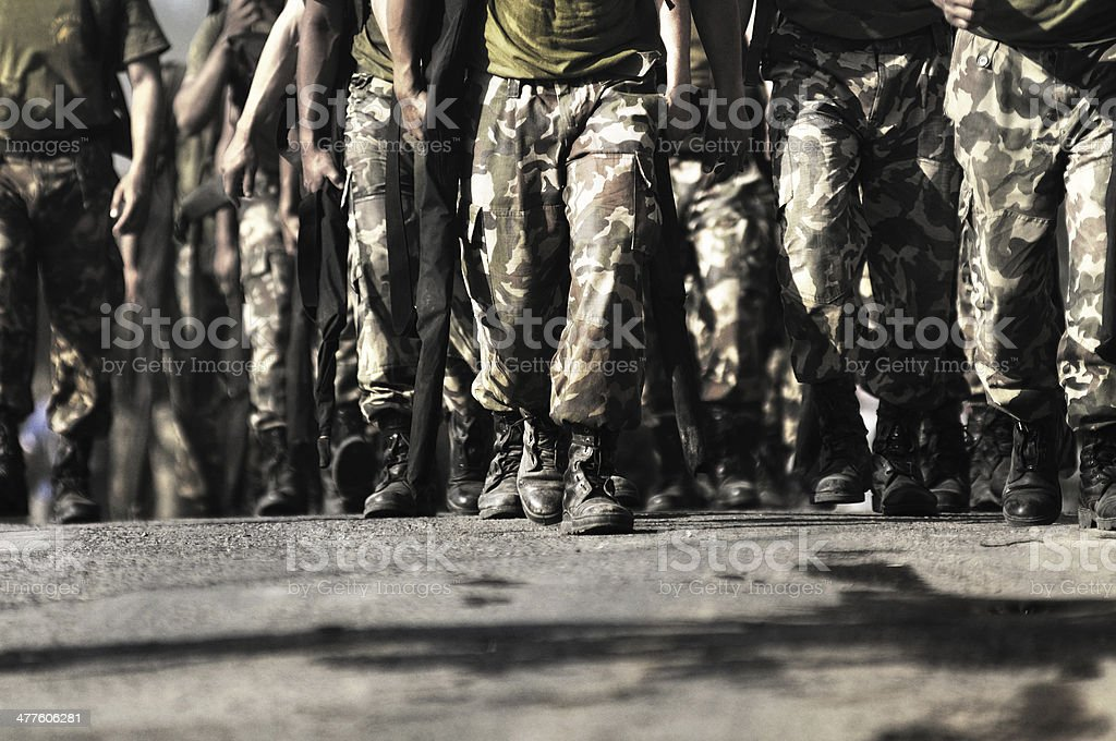 soldier walking towards camera stock photo