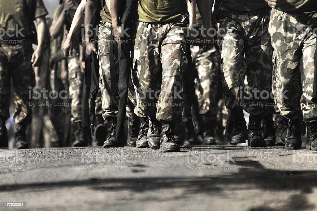 soldier walking towards camera stock photo