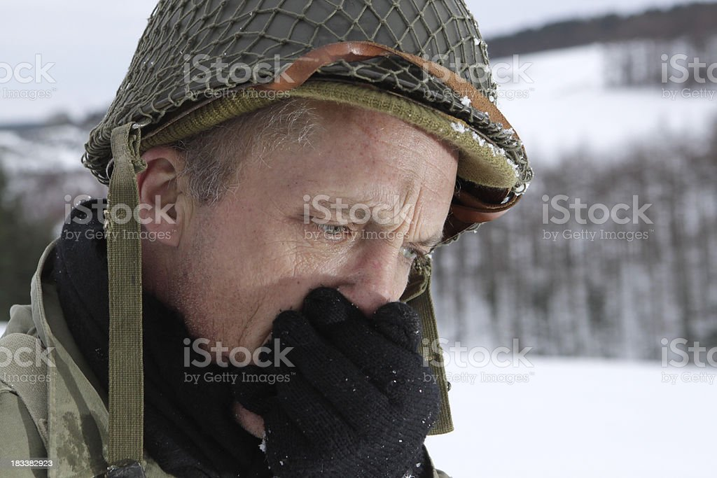 Soldier warming hands stock photo