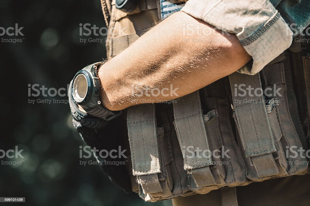 soldier wearing a bulletproof vest stock photo