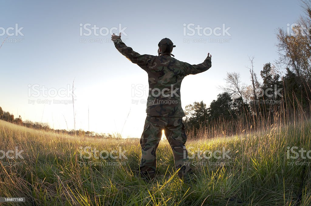 Soldier Welcomes Peaceful Light stock photo