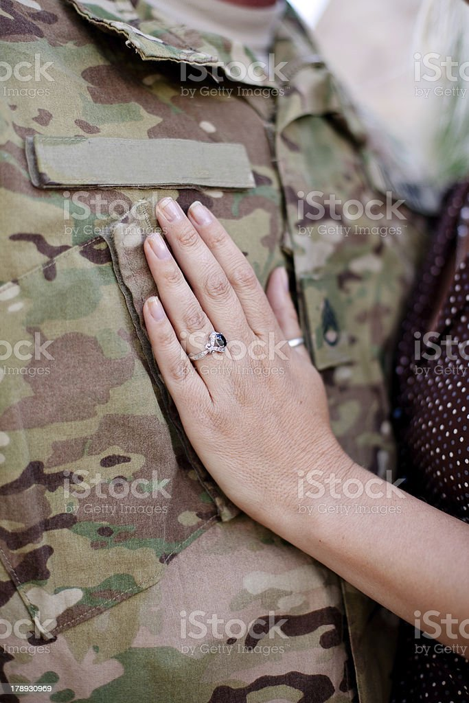 Soldier wife's hand stock photo