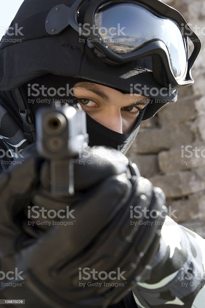 Soldier with a pistol royalty-free stock photo